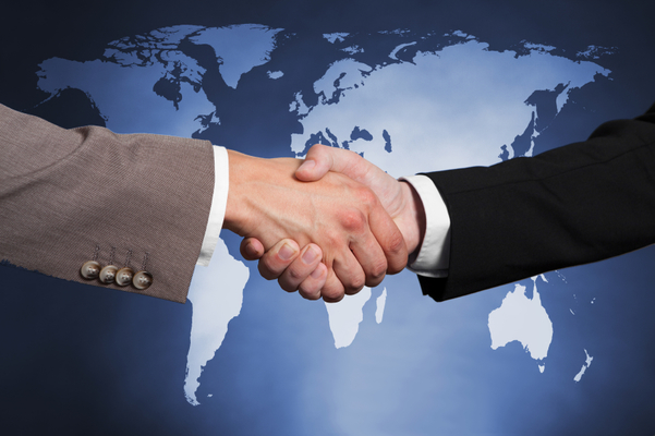 Cropped image of businessmen shaking hands against worldmap. Source of reference map: http://visibleearth.nasa.gov/view.php?id=74518. Illustration was created on the 15th of May, 2014 using Photoshop CS5. 1 layer of data was used for the outline of the world map.
